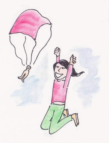 A girl delights in playing with a toy soldier parachute.